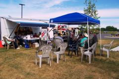 Members relaxing by our trailer at a truck show.